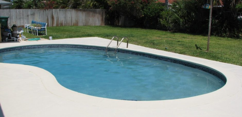 pool deck flooring solutions - pool in backyard