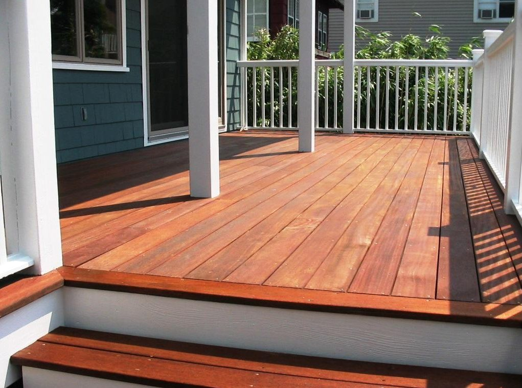 ArmorDeck for Wood Decks - red wood deck with white railing